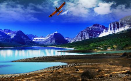 Фото пейзаж, озеро горы, и синие небо и летящий самолёт