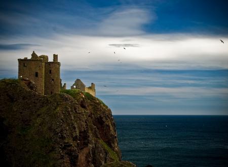 Заставки замок, Данноттар, Шотландия, море