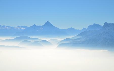 Обои горы, пики, небо, дымка